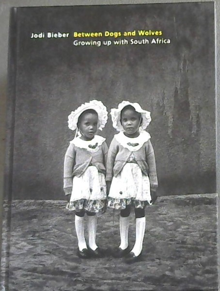 Image for Between Dogs and Wolves: Growing up with South Africa